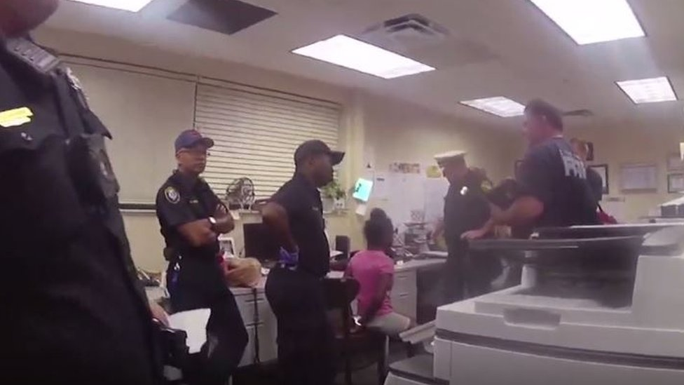 Officers arresting the girl