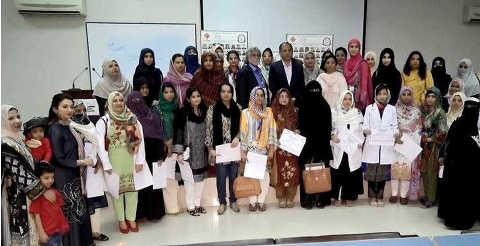 A group of female doctors who finished their refresher course