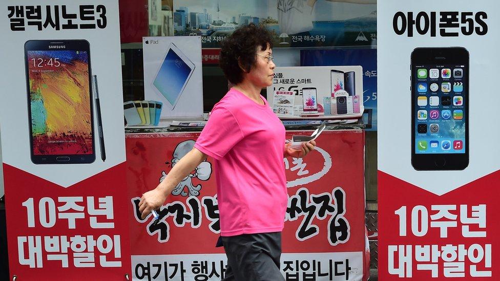 Woman walking in Seoul street