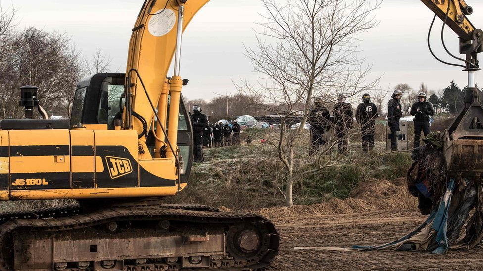 """Bulldozer clears part of the makeshift Calais camp called the """"Jungle"""""""