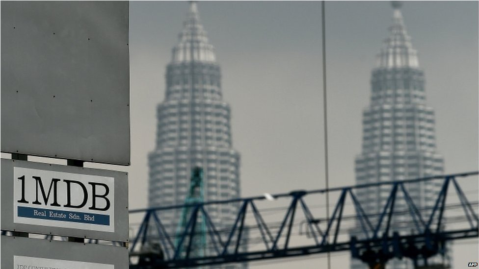 The 1 Malaysia Development Berhad (1MDB) logo is seen on a billboard at the funds flagship Tun Razak Exchange under-development site in Kuala Lumpur on 3 July 2015