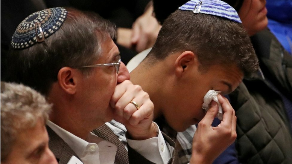 Mourners crying during the memorial service