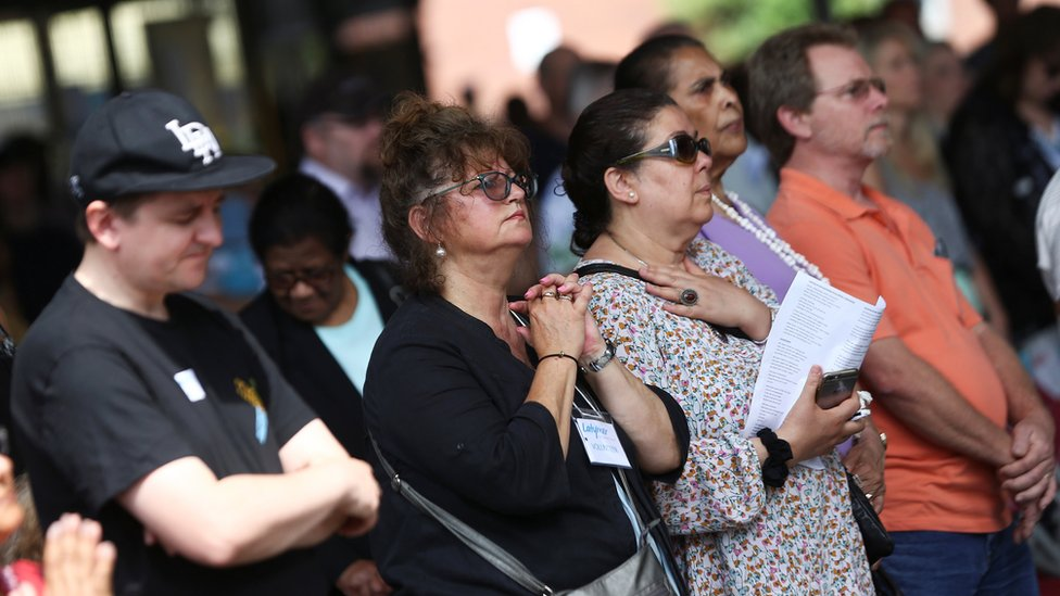 People attend a service at a church near the Grenfell Tower in North Kensington