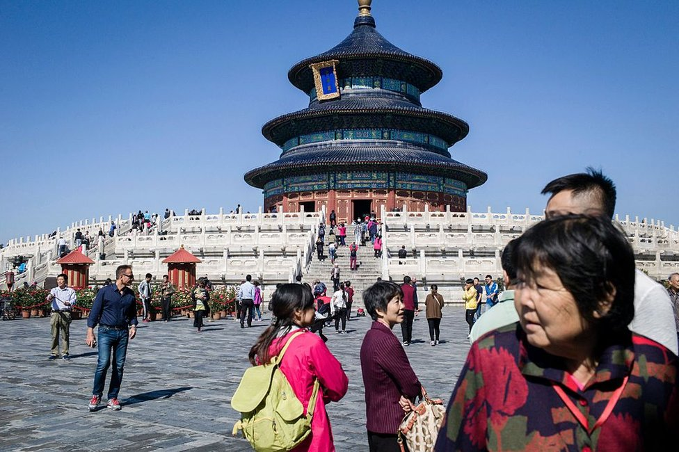 Tourists visit Temple of Heaven in Beijing on 28 September 2016 ahead of Golden Week, a week-long holiday that coincides with the anniversary of the founding of the People's Republic of China which falls on October 1.