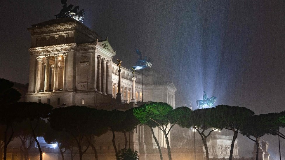 Water pours over the Altare della Patria (Altar of the Fatherland), the national monument to Italian King Victor Emmanuel II in Rome