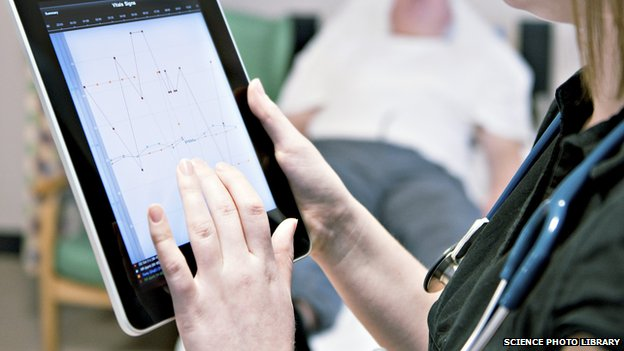A doctor using a tablet