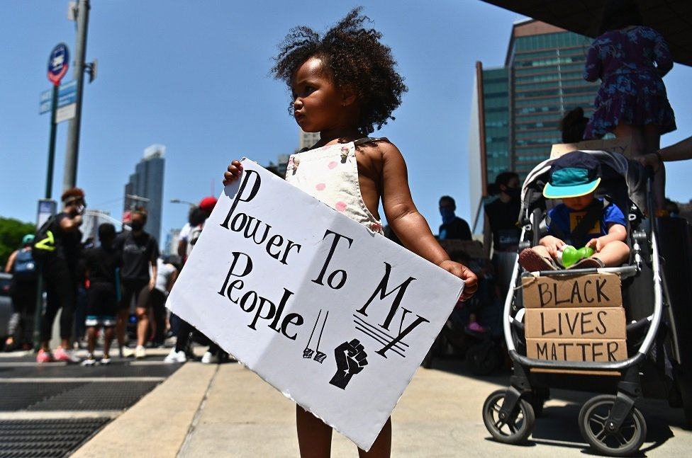 Families participate in a children's march in solidarity with the Black Lives Matter movement and national protests against police brutality on 9 June 2020 in the Brooklyn Borough of New York City