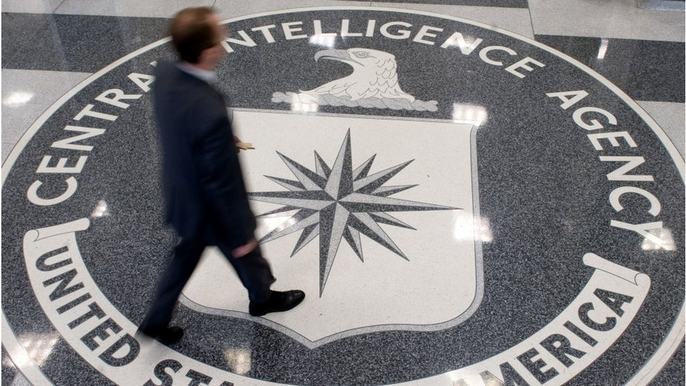 A man crosses the Central Intelligence Agency (CIA) seal in the lobby of CIA Headquarters in Langley, Virginia, on August 14, 2008
