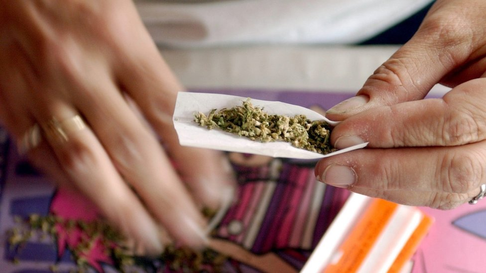 Woman rolls a marijuana joint in San Francisco, California