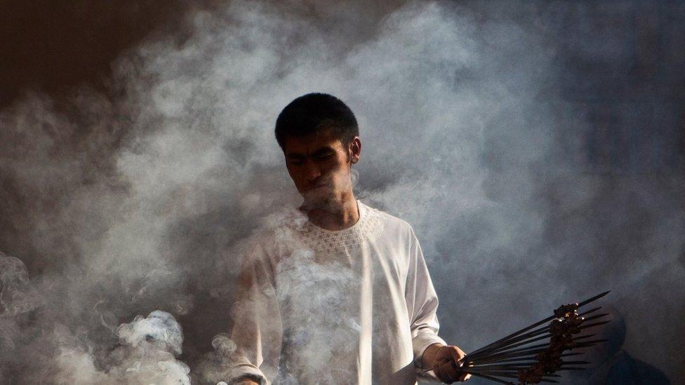 A man makes kebab at a restaurant in Kabul