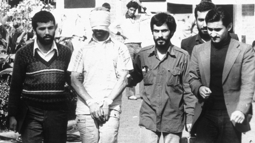An American hostage is shown before the media by his Iranian captors in this 1979 file photo