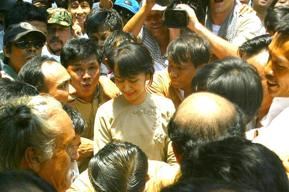Aung San Suu Kyi, swarmed by supporters on her release after 19 months of house arrest in 2002