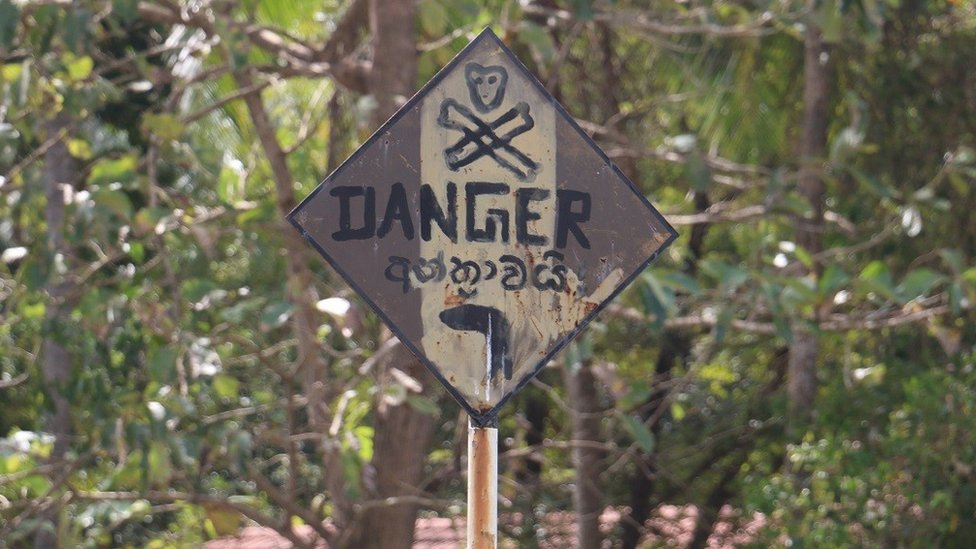 Villagers have erected a sign warning people to avoid the school