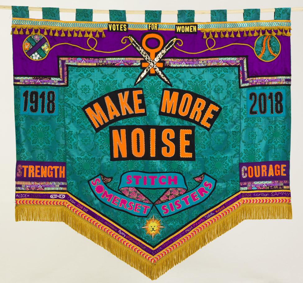 """Somerset Art Works banner reading """"Make more noise"""""""