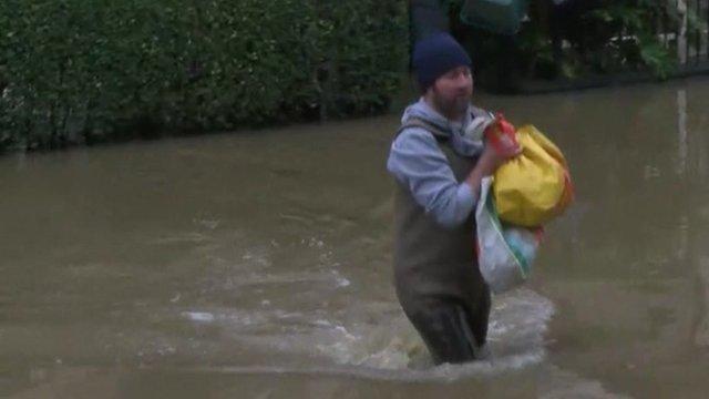 Man wading through water in York