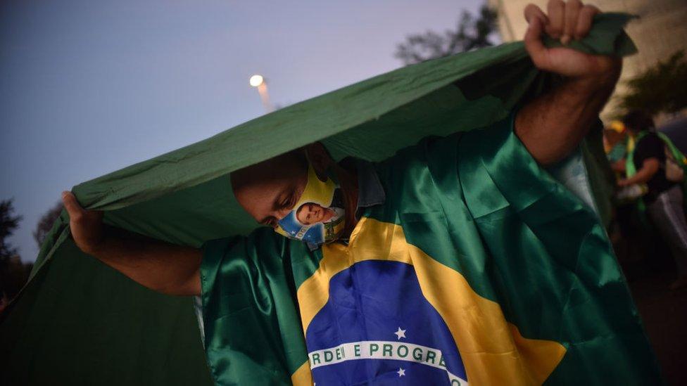 Supporters of Brazil's President Jair Bolsonaro take part in a protest in front of the Superior Electoral Tribunal (TSE), amid the Coronavirus (COVID-19) outbreak, in Brasilia Brazil June 9, 2020