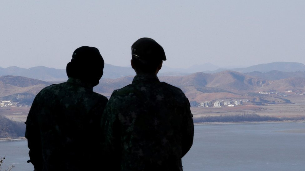 South Korean army soldiers watch the North Korean side at the unification observation post in Paju, near the border with North Korea, South Korea, 23 February