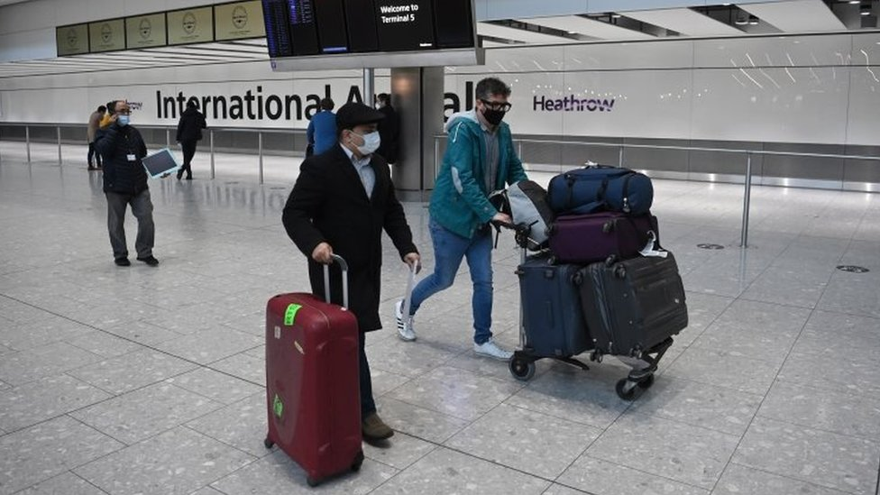 Travellers in the international arrival area of Heathrow Airport on 18 January 2021