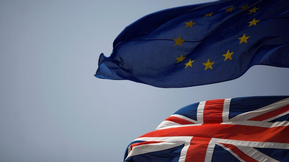 Union Jack next to the EU flag