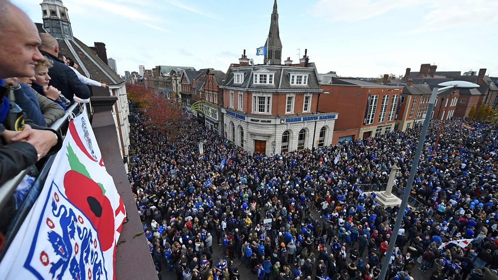 Leicester City fans march in honour of owner