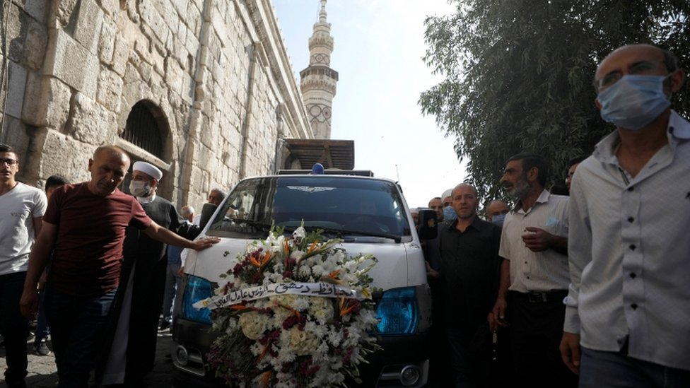 Mourners in a Damascus street