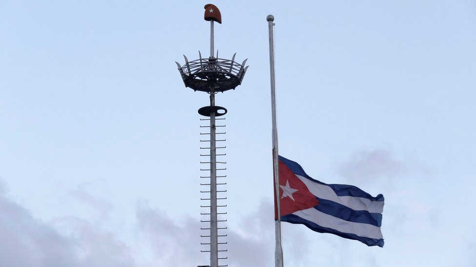 The Cuban flag flies at half mast in Revolution Square in Havana