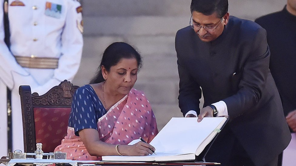 The Bharatiya Janata Party's Nirmala Sitharaman signs papers after taking oath as a cabinet minister during the swearing-in ceremony on May 30, 2019 in Delhi, India