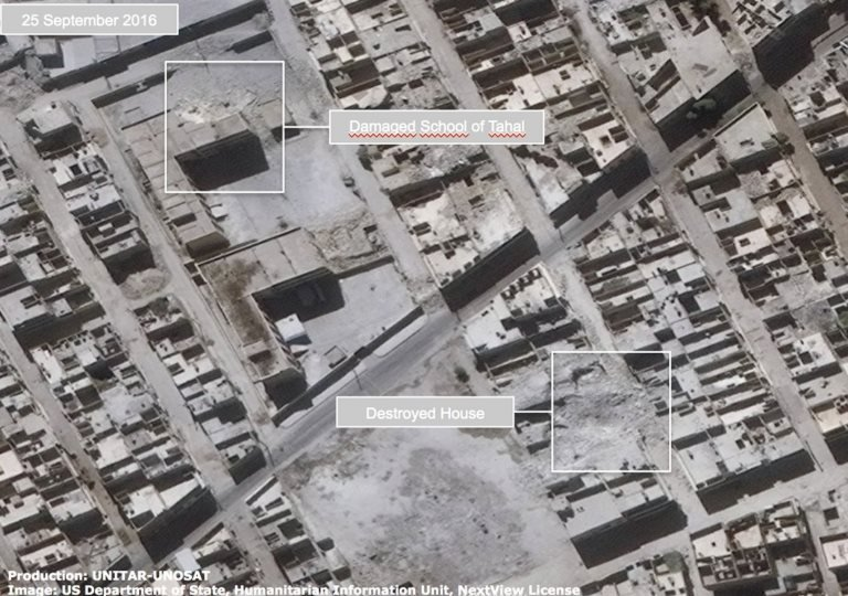 Satellite image shows destroyed houses and a damaged house in the Tahal Jabal Badro district of Aleppo on 25 September