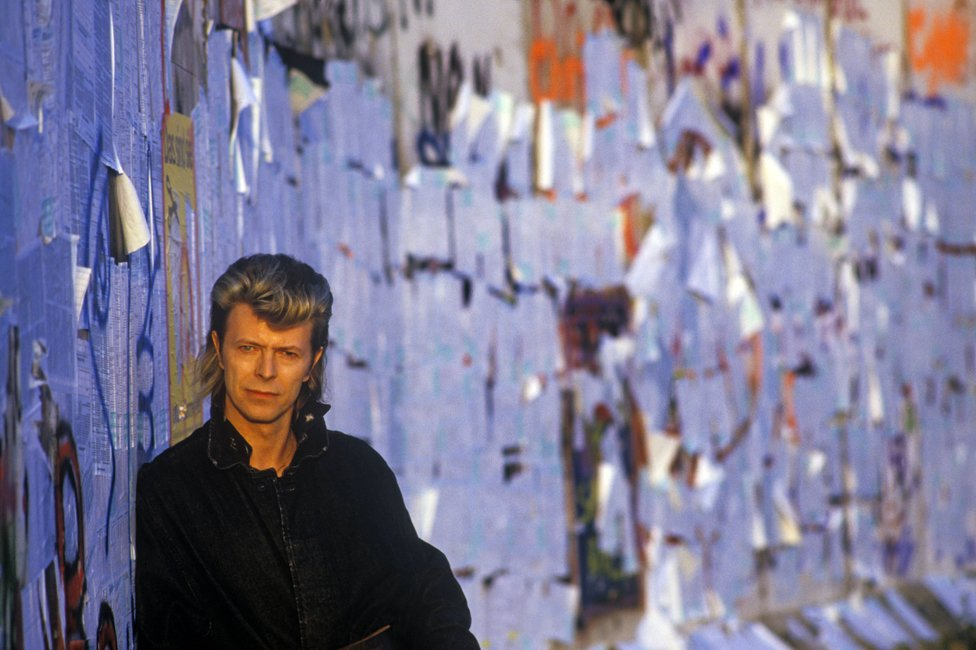 David Bowie by the Berlin Wall