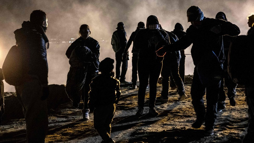 US border agents fire tear gas at migrants on the Mexican border