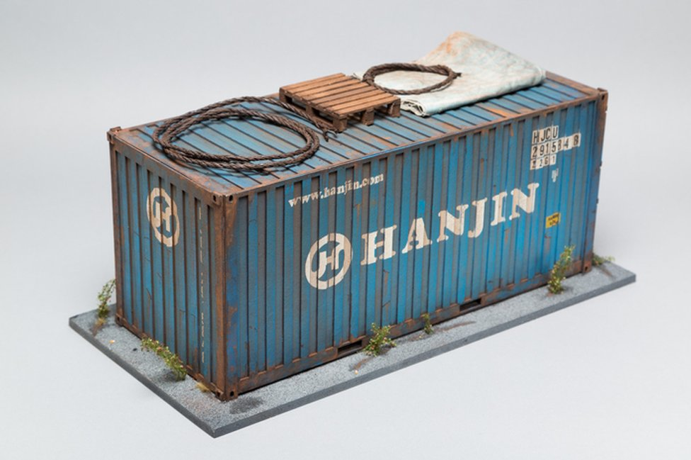 A small model of a shipping container