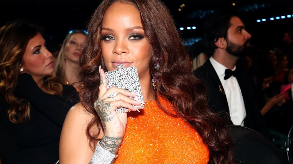 Rihanna with her hip flask