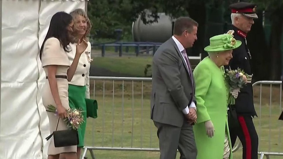 Loud cheers for Queen and Meghan at event