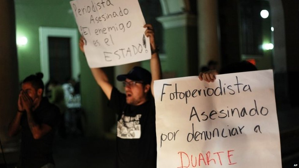 Journalists hold a late night vigil to protest against the latest murder of a fellow journalist in Veracruz on 1 August, 2015