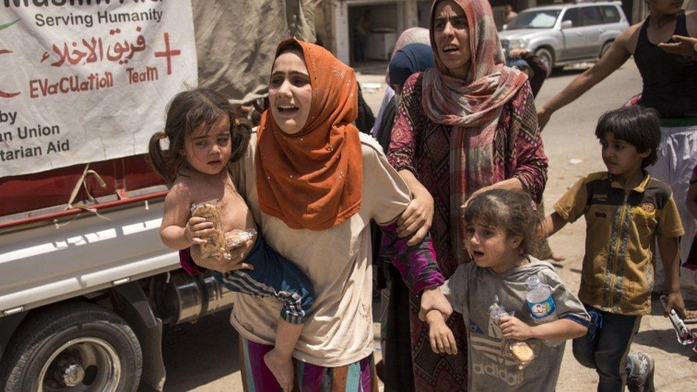 Iraqi women and children fleeing fighting in the Old City of Mosul 8 July 2017