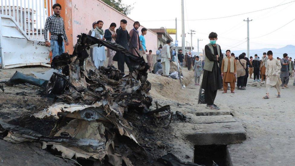 Wreckage outside a Kabul school following bombings in May 2021