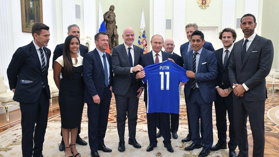 Russian President Vladimir Putin meets with former international footballers