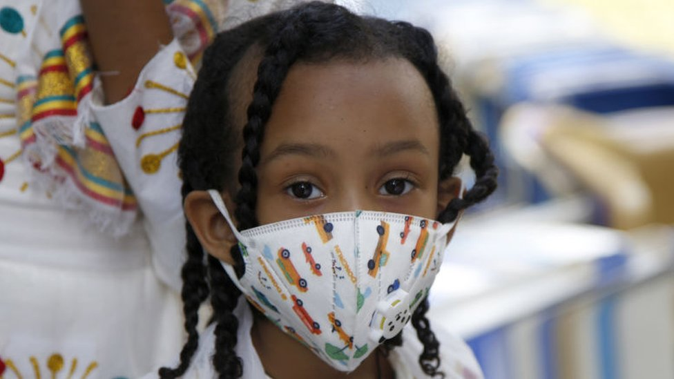 People wearing face masks as a precautionary measure against the coronavirus (Covid-19) come to Entoto Kidane Mehret Church as Ethiopian Orthodox Christians celebrate Filseta Day after the end of fasting for 15 days without consuming animal products in commemoration of Assumption of Mary in Addis Ababa, Ethiopia on August 22, 2020