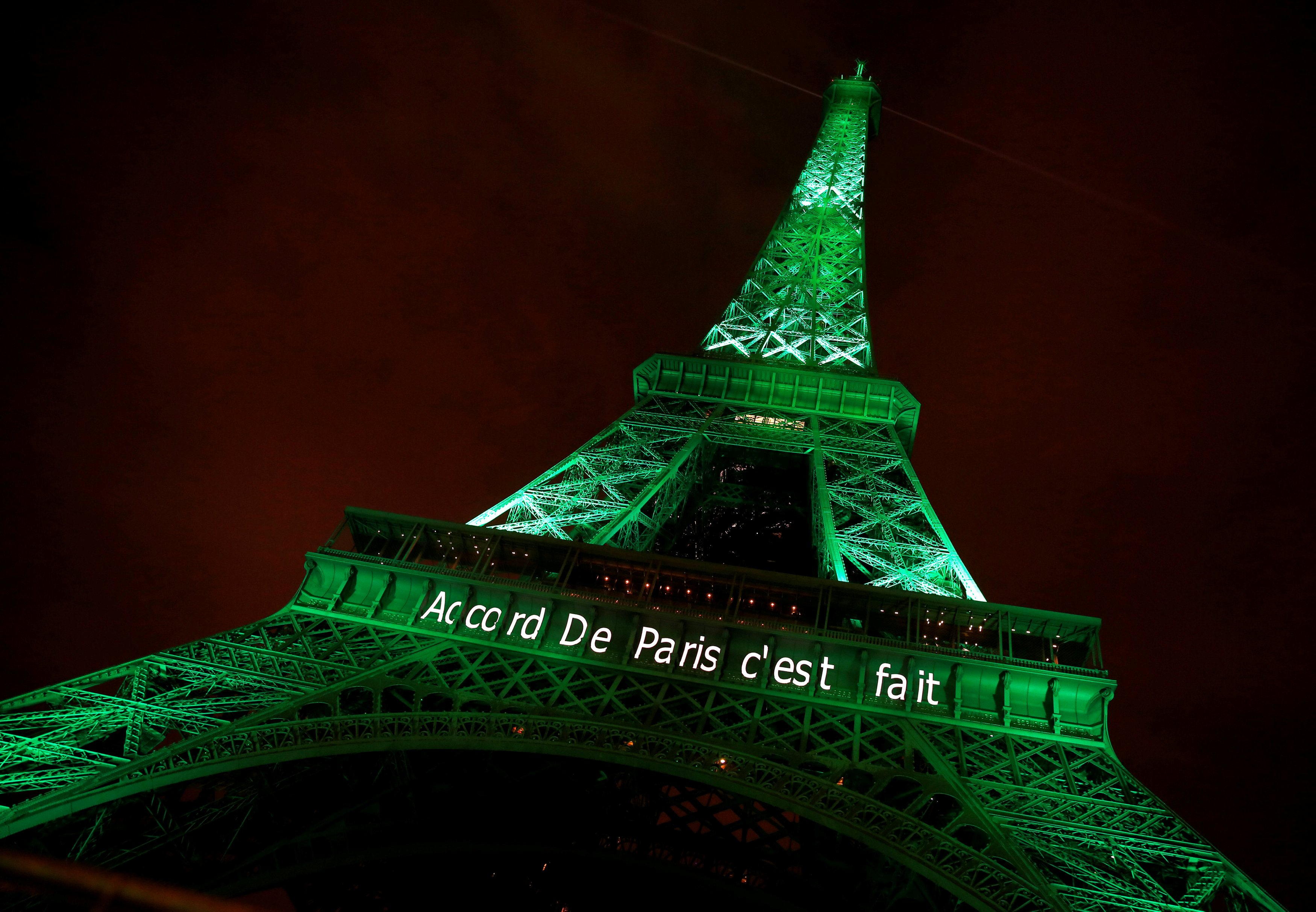 """The Eiffel tower is illuminated in green with the words """"Paris Agreement is Done"""", to celebrate the Paris U.N. COP21 Climate Change agreement"""