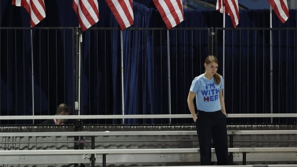 """A Clinton supporter stands alone in the bleachers after Democratic presidential nominee Hillary Clinton""""s election night rally was cancelled at the Jacob Javits Center in New York, Wednesday, Nov. 9, 2016"""