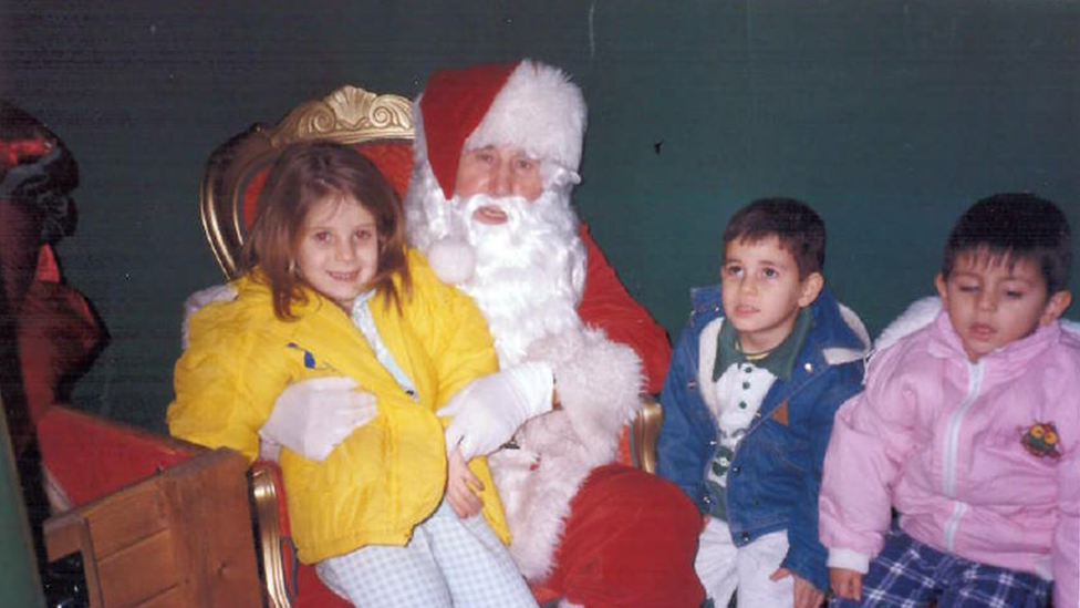 Allan and his siblings meeting Father Christmas