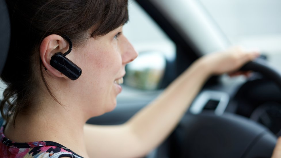 Woman with hands-free mobile