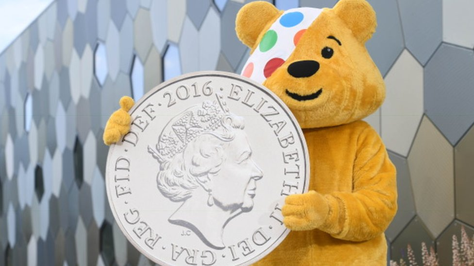 Pudsey Bear with a coin