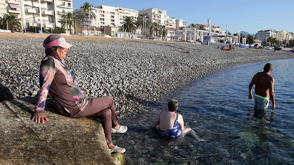 A French woman wears a burkini on a beach in the city of Nice, south-eastern France, on 26 August 2016