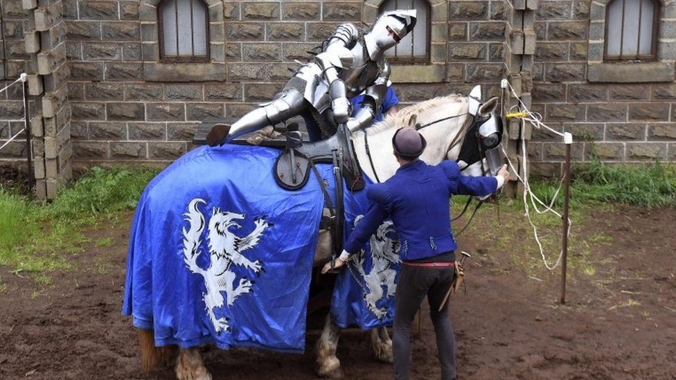 A jouster climbs on to his horse in Victoria, Australia