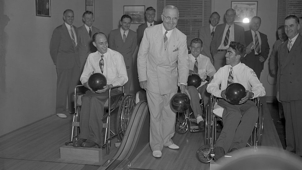 President Truman presents awards to three paralysed bowling champions at the White House