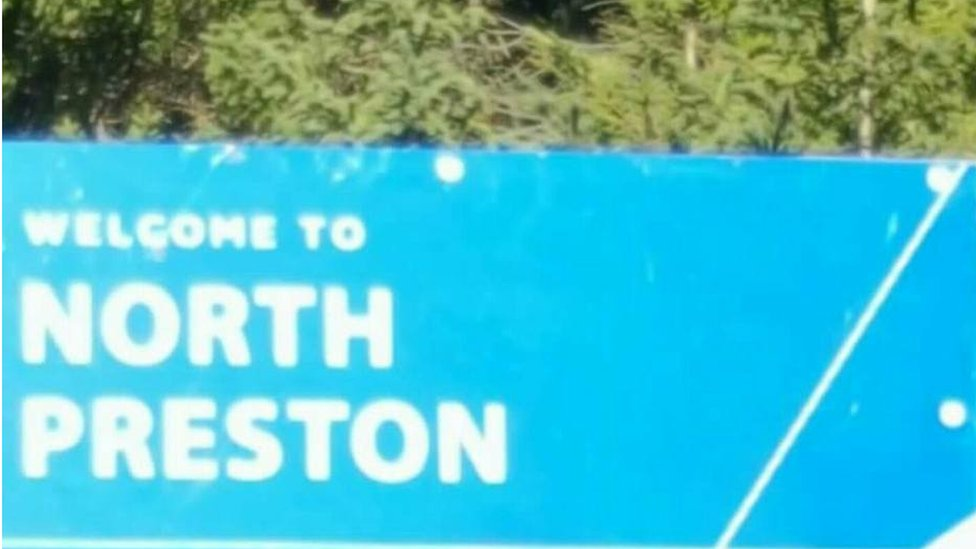A roadside sign welcoming people to the community of North Preston