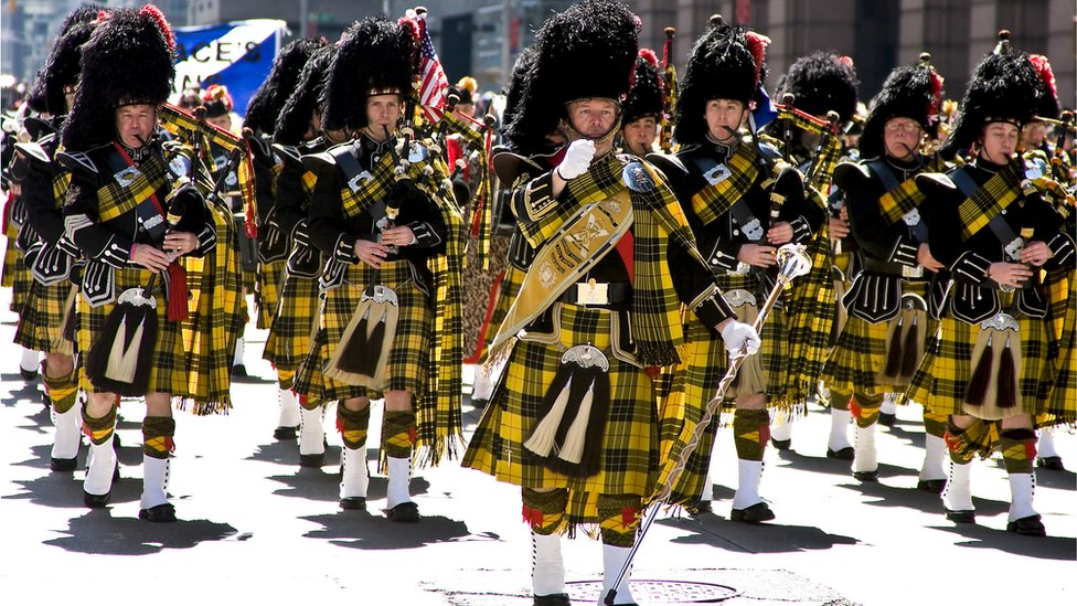 Pipe band marches in Tartan Day parade