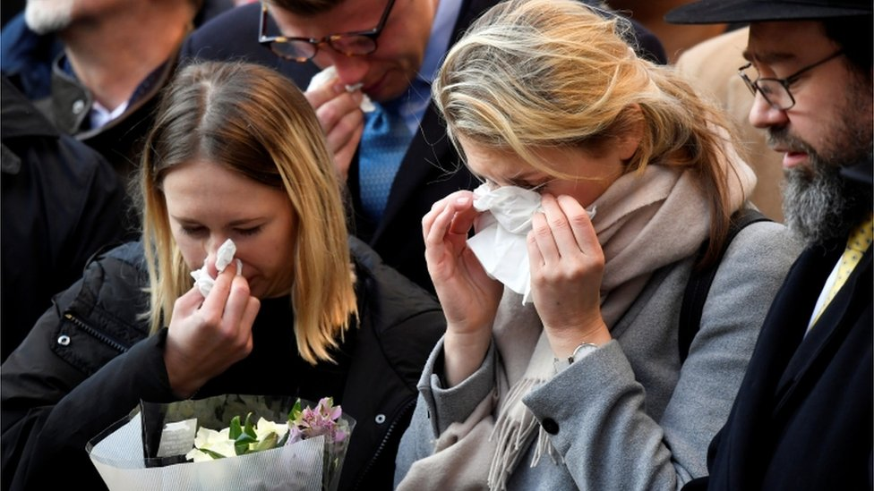 Members of the public at a vigil for victims of a fatal attack on London Bridge in London