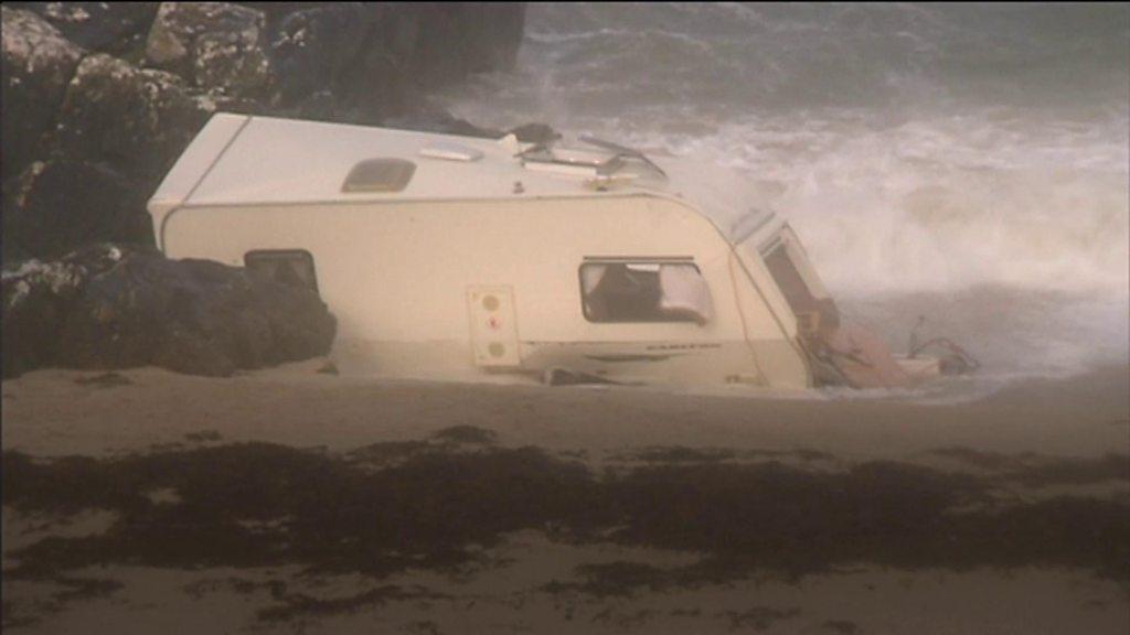 Storm Ali: Woman dies as caravan is blown off cliff